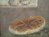 Roman bread was baked from various grains, barley being among the most common ingredients.