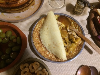 Crepes with chicken cooked in spiced wine with apples